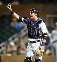 Salt River Rafters catcher Lars Davis #55, of the Colorado Rockies organization, during an Arizona Fall League game against the Peoria Javelinas at the Salt River Fields at Talking Stick on October 18, 2012 in Scottsdale, Arizona.  Peoria defeated Salt River 3-1.  (Mike Janes/Four Seam Images via AP Images)