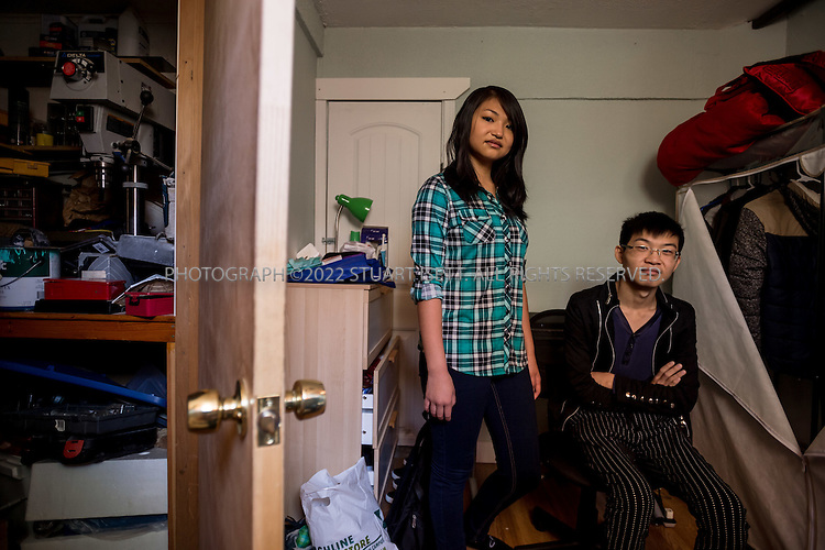 SEATAC, USA - SEPTEMBER 24th, 2015<br /> <br /> Ricki Mudd, 22, &amp; her brother Chao Wu, 20, in Ricki&rsquo;s parents home in Seatac, Washington, USA. Here the siblings pose in Chao's bedroom in the basement,<br /> <br /> (Photo by Stuart Isett for The Washington Post)