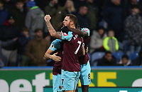 West Ham United's Mark Noble celebrates scoring his side's first goal with Marko Arnautovic and Cheikhou Kouyate<br /> <br /> Photographer Rob Newell/CameraSport<br /> <br /> The Premier League - Huddersfield Town v West Ham United - Saturday 13th January 2018 - John Smith's Stadium - Huddersfield<br /> <br /> World Copyright &copy; 2018 CameraSport. All rights reserved. 43 Linden Ave. Countesthorpe. Leicester. England. LE8 5PG - Tel: +44 (0) 116 277 4147 - admin@camerasport.com - www.camerasport.com