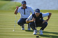 Dustin Johnson (Team USA) lines up his putt with Brooks Koepka (Team USA) during Saturday's foursomes of the 2018 Ryder Cup, Le Golf National, Guyancourt, France. 9/29/2018.<br /> Picture: Golffile | Ken Murray<br /> <br /> <br /> All photo usage must carry mandatory copyright credit (© Golffile | Ken Murray)