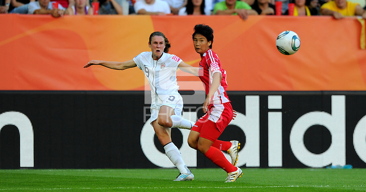 Heather O'Reilly (l) of Team USA and Ho Un Byol of North Korea during the FIFA Women's World Cup at the FIFA Stadium in Dresden, Germany on June 28th, 2011.