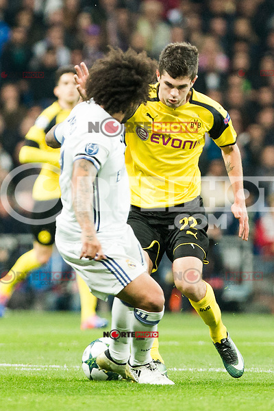 Real Madrid's Marcelo Vieira, Borussia Dortmund Christian Pullsic during Champions League match between Real Madrid and Borussia Dortmund  at Santiago Bernabeu Stadium in Madrid , Spain. December 07, 2016. (ALTERPHOTOS/Rodrigo Jimenez) /NortePhoto.com