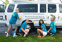 Freshmen Cole Hinchey, Danny Philbrick, Regina MCcann and Emily Parkhurst and  wash one of the Martin Luther King Center vans as they volunteer during the Salve Regina University Exploration Day in Newport.