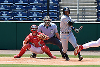 Tampa Yankees second baseman Angelo Gumbs (21) at bat in front of catcher Logan Moore (10) and umpire Brennan Miller during a game against the Clearwater Threshers on April 9, 2014 at Bright House Field in Clearwater, Florida.  Tampa defeated Clearwater 5-3.  (Mike Janes/Four Seam Images)