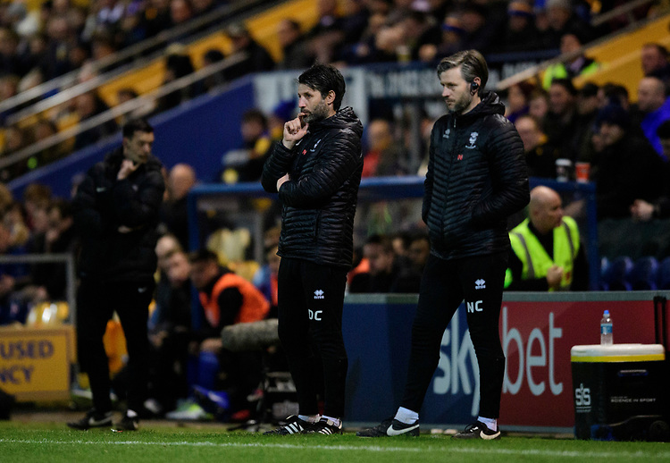 Lincoln City manager Danny Cowley, left, and Lincoln City's assistant manager Nicky Cowley<br /> <br /> Photographer Chris Vaughan/CameraSport<br /> <br /> The EFL Sky Bet League Two - Mansfield Town v Lincoln City - Monday 18th March 2019 - Field Mill - Mansfield<br /> <br /> World Copyright © 2019 CameraSport. All rights reserved. 43 Linden Ave. Countesthorpe. Leicester. England. LE8 5PG - Tel: +44 (0) 116 277 4147 - admin@camerasport.com - www.camerasport.com
