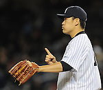 Masahiro Tanaka (Yankees), APRIL 9, 2014 - MLB : New York Yankees starting pitcher Masahiro Tanaka reacts during the MLB game between the New York Yankees and the Baltimore Orioles at Yankee Stadium in The Bronx, New York, United States. (Photo by AFLO)