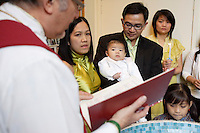 Montreal (qc) CANADA -November 2009 file Photo-.A Filipino baby boy get baptized by a Catholic priest.(model releases signed by parents only , for editorial use)