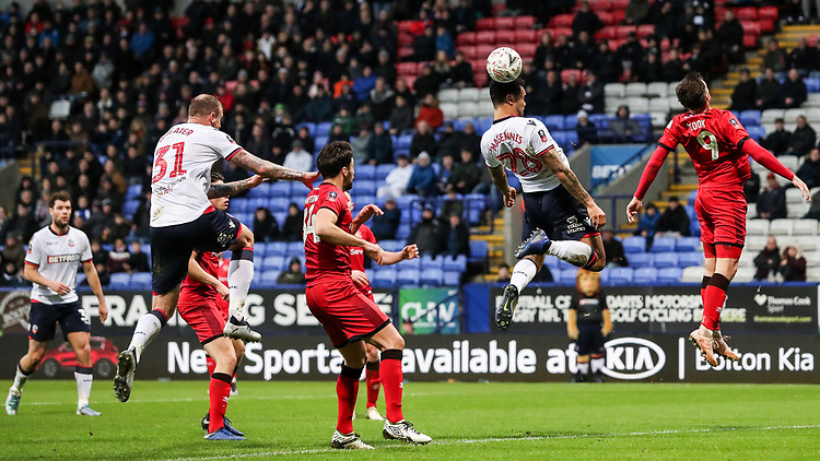 Bolton Wanderers' Josh Magennis meets a corner kick<br /> <br /> Photographer Andrew Kearns/CameraSport<br /> <br /> Emirates FA Cup Third Round - Bolton Wanderers v Walsall - Saturday 5th January 2019 - University of Bolton Stadium - Bolton<br />  <br /> World Copyright © 2019 CameraSport. All rights reserved. 43 Linden Ave. Countesthorpe. Leicester. England. LE8 5PG - Tel: +44 (0) 116 277 4147 - admin@camerasport.com - www.camerasport.com