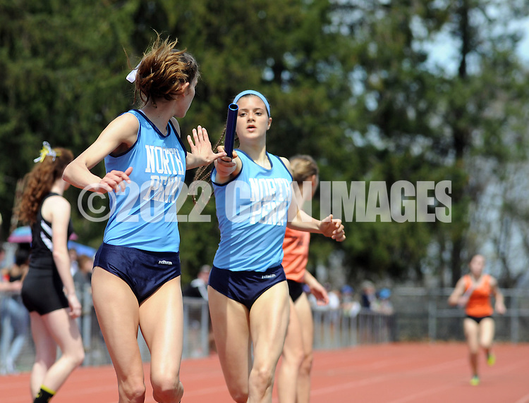 North Penn's Mikaela Vlasic (R) hands off to Phoebe Clowser during the 4x800 relay at the Central Bucks West Relays Saturday April 18, 2015 in Doylestown, Pennsylvania.  (Photo by William Thomas Cain/Cain Images)