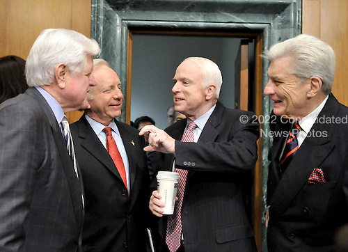 "Washington, DC - April 8, 2008 -- From left to right: United States Senators Edward M. ""Ted"" Kennedy, (Democrat of Massachusetts); Joseph I. Lieberman (Independent Democrat of Connecticut), John McCain (Republican of Arizona); and John Warner (Republican of Virginia) share a conversation prior to hearing the testimony of General David Petraeus and Ambassador Ryan Crocker before the United States Senate Armed Services Committee on the situation and progress in Iraq in Washington, D.C. on Tuesday, April 8, 2008..Credit: Ron Sachs / CNP"