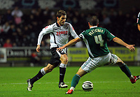 ATTENTION SPORTS PICTURE DESK<br /> Pictured: Angel Rangel of Swansea (L) closely marked by Carl Fletcher (R) of Plymouth Argyle<br /> Re: Coca Cola Championship, Swansea City Football Club v Plymouth Argyle at the Liberty Stadium, Swansea, south Wales. Tuesday 08 December 2009