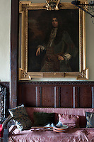 The gilt-framed portrait of Endymion Porter by van Dyck hangs on a wall of the staircase hall