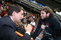 Quebec City, January 31, 2007 - PQ leader André Boisclair chats with Jeff Baby during the first intermission of the the Quebec Remparts game against the Val d?Or Foreurs at the Pepsi Colisée in Quebec City January 31, 2007. Boisclair, recently under attack by both party faithful and detractors not to mention down the polls, has promised to meet these challenges straight on.