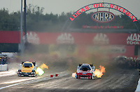 Aug. 31, 2012; Claremont, IN, USA: NHRA funny car driver Jeff Arend (left) races alongside Bob Tasca III during qualifying for the US Nationals at Lucas Oil Raceway. Mandatory Credit: Mark J. Rebilas-