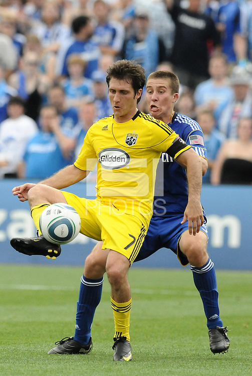 Guillermo Barros Schelotto (yellow), Matt Besler...Kansas City Wizards were defeated 1-0 by Columbus Crew at Community America Ballpark, Kansas City, Kansas.