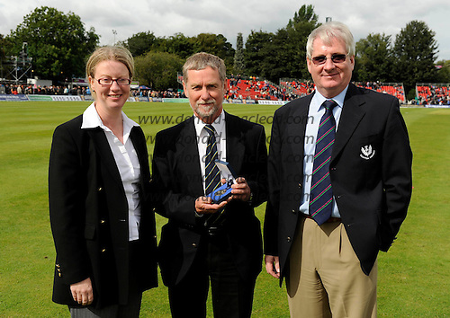 Scotland V Australia ODI at Grange CC, Edinburgh - Shona Robison, Minister for Public Health and Sport in the Scottish Government left) and Jim Young, President, Cricket Scotland (right), presents David Bridges with his ICC Centenary Medal, to mark his cricket volunteer achievements over a numbers of years in Scotland - Picture by Donald MacLeod 28.08.09