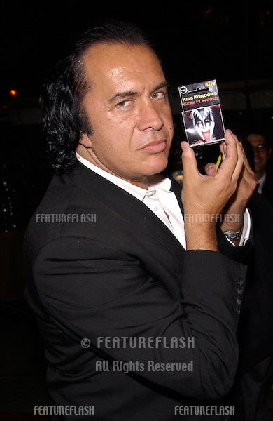 KISS star GENE SIMMONS at the world premiere, in Hollywood, of Domestic Disturbance. Gene was showing off a pack of KISS condoms, the KISS mobile phone, and the KISS credit card..30OCT2001.  © Paul Smith/Featureflash