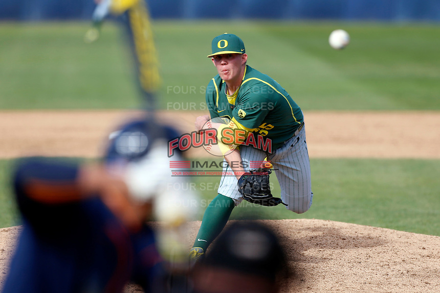 Garrett Cleavinger #35 of the Oregon Ducks pitches against the Cal State Fullerton Titans at Goodwin Field on March 3, 2013 in Fullerton, California. (Larry Goren/Four Seam Images)