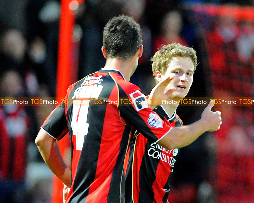 Eunan O'Kane of AFC Bournemouth is congratulated by Andrew Surman of AFC Bournemouth - AFC Bournemouth vs Yeovil Town - Sky Bet Championship Football at the Goldsands Stadium, Bournemouth, Dorset - 26/12/13 - MANDATORY CREDIT: Denis Murphy/TGSPHOTO - Self billing applies where appropriate - 0845 094 6026 - contact@tgsphoto.co.uk - NO UNPAID USE