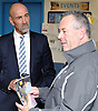 Retired New York Islanders great Bob Nystrom, left, speaks with attendees of an open house at New York Institute of Technology's Center for Sports Medicine on Thursday, Dec. 17, 2015. The center includes numerous machines used to treat and diagnose concussions.