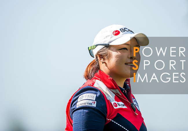 Ha-Na Jang of Korea looks on during the Hyundai China Ladies Open 2014 at World Cup Course in Mission Hills Shenzhen on December 14 2014, in Shenzhen, China. Photo by Xaume Olleros / Power Sport Images