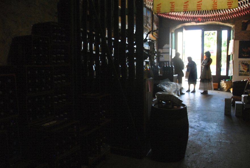 Customers purchase wine at a shop in Le Puy-en-Velay, France.