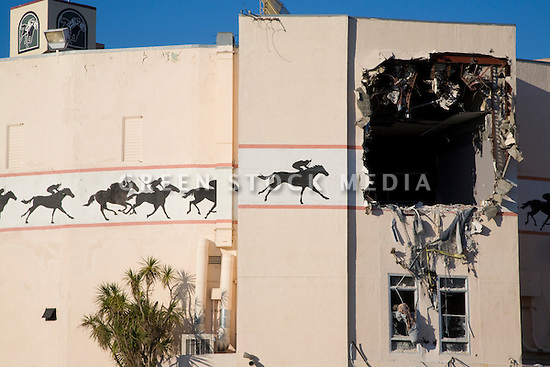 A close up of a Bay Meadows Race Track building with a hole for disposing debris. Demolition of the Bay Meadows Race Track facilities took place from September to October 2008. The horse racing track was demolished to make way for a large mixed use development including office space, residential units, retail space, and public parks. The site is located right next to the Hillsdale Caltrain station making it a perfect location for a transit oriented development (TOD) project. San Mateo, California, USA