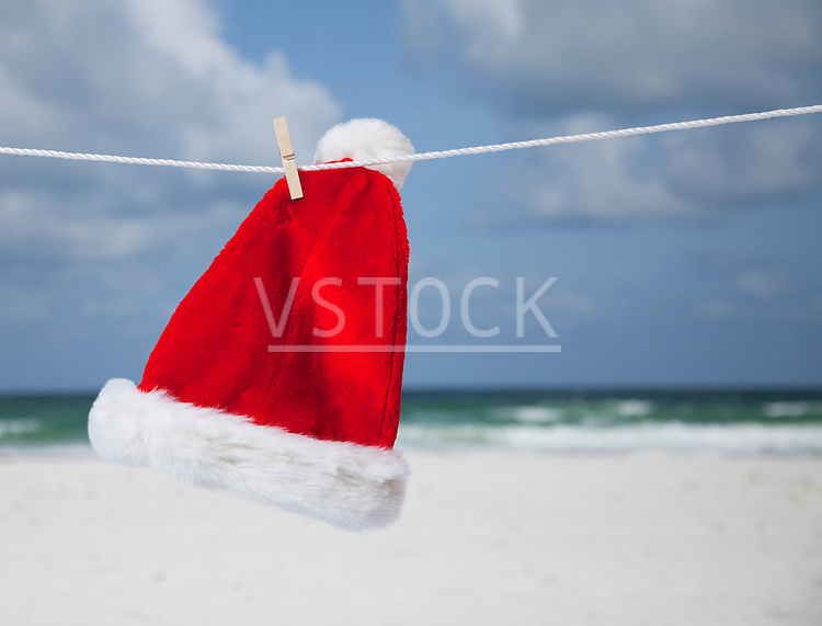 USA, Florida, St. Pete Beach, Santa hat hanging on clothesline on beach