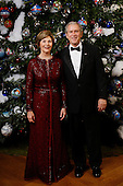 United States President George W. Bush and first lady Laura Bush pose for their 2008 holiday portrait Sunday, December 7, 2008, in the Blue Room of the White House in Washington, D.C. .Mandatory Credit: Eric Draper / White House via CNP.