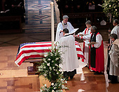 December 5, 2018 - Washington, DC, United States: Clergy prays over the casket at the state funeral service of former President George W. Bush at the National Cathedral.  <br /> Credit: Chris Kleponis / Pool via CNP