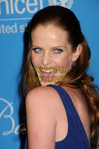 REBECCA MADER .UNICEF Ball 2009 Honoring Jerry Weintraub held at the Beverly Wilshire Hotel, Beverly Hills, California, USA..December 10th, 2009.headshot portrait blue mouth open looking over shoulder .CAP/ADM/BP.©Byron Purvis/AdMedia/Capital Pictures.