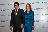 David Copperfield, left, and Chloe Gosselin, right, arrive for the formal Artist's Dinner honoring the recipients of the 42nd Annual Kennedy Center Honors at the United States Department of State in Washington, D.C. on Saturday, December 7, 2019. The 2019 honorees are: Earth, Wind & Fire, Sally Field, Linda Ronstadt, Sesame Street, and Michael Tilson Thomas.<br /> Credit: Ron Sachs / Pool via CNP