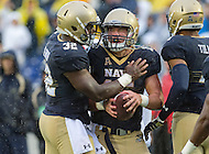 Annapolis, MD - OCT 8, 2016: Navy Midshipmen quarterback Will Worth (15) celebrates with his teammate Navy Midshipmen fullback Myles Swain (32) following a first quarter touchdown during game between Houston and Navy at Navy-Marine Corps Memorial Stadium Annapolis, MD. The Midshipmen upset #6 Houston 46-40. (Photo by Phil Peters/Media Images International)