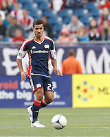 New England Revolution forward Benny Feilhaber (22) passes the ball. In a Major League Soccer (MLS) match, the New England Revolution tied the Columbus Crew, 0-0, at Gillette Stadium on June 16, 2012.