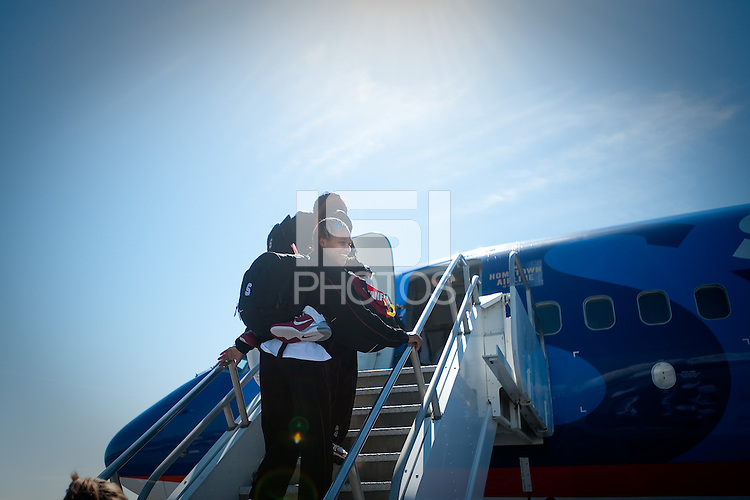 SAN JOSE, CA - MARCH 31, 2011: Melanie Murphy boards the plane en route to the NCAA Final Four at the San Jose International Airport on March 31, 2011.