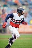 Syracuse Chiefs designated hitter Irving Falu (10) runs to first base during a game against the Scranton/Wilkes-Barre RailRiders on June 14, 2018 at NBT Bank Stadium in Syracuse, New York.  Scranton/Wilkes-Barre defeated Syracuse 9-5.  (Mike Janes/Four Seam Images)