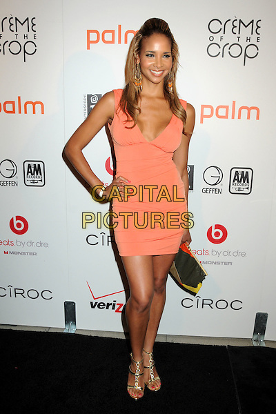 "BRACHA KRUEGER .Interscope Geffen A&M Records 4th Annual ""Creme of the Crop"" Post BET Awards 2010 Celebration held at Mr. Chow Restaurant, Beverly Hills, California, USA..June 27th, 2010.full length orange peach dress hand on hip.CAP/ADM/BP.©Byron Purvis/AdMedia/Capital Pictures."