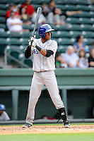 Shortstop Luis Jean (3) of the Asheville Tourists bats in a game against the Greenville Drive on Friday, April 24, 2015, at Fluor Field at the West End in Greenville, South Carolina. Greenville won, 5-2. (Tom Priddy/Four Seam Images)