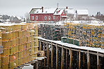 Fresh snow covers lobster traps in Corea, a fishing village on the Schoodic National Scenic Byway - Corea village, Gouldsboro, Downeast ME, USA