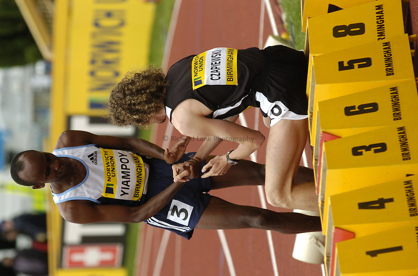 Photo. Richard Lane. Norwich Union International. Alexander Stadium, Birmingham. 25/07/2004..Mens 800m..Pawel Czapiewski congratulates William Yiampoy on winning the race.