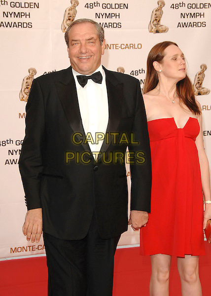 DICK WOLF & GUEST.At the Golden Nymph awards ceremony during the 2008 Monte Carlo Television Festival held at Grimaldi Forum, Monte Carlo, Principality of Monaco, .June 12, 2008..half length red dress tuxedo bow tie.CAP/TTL .©TTL/Capital Pictures