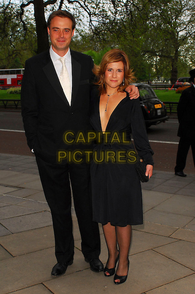 JAMIE THEAKSTON & HARRIET SCOTT.Arrivals at the Sony Radio Academy Awards 2006 at Grosvenor House Hotel, London, UK..May 8th, 2006.Ref: CAN.full length black suit dress plunging neckline clutch purse.www.capitalpictures.com.sales@capitalpictures.com.© Capital Pictures.