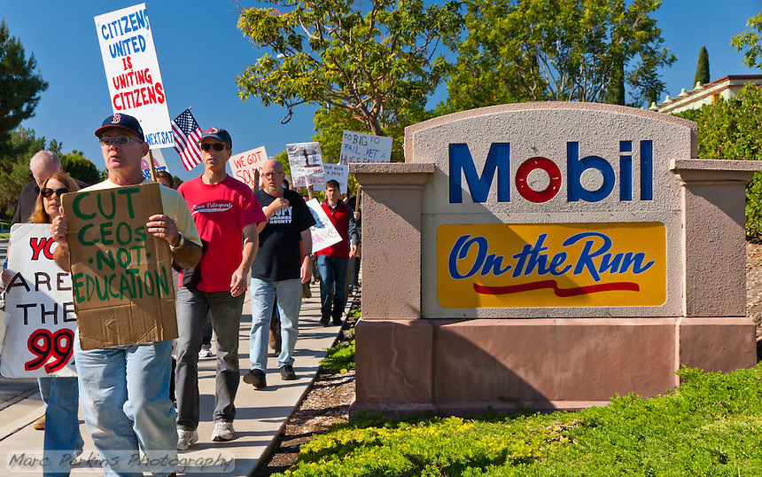 "The ""On the run"" tagline of Mobil takes on a new meaning as protesters march past it during the Saturday November 5 Occupy Orange County march in Irvine."