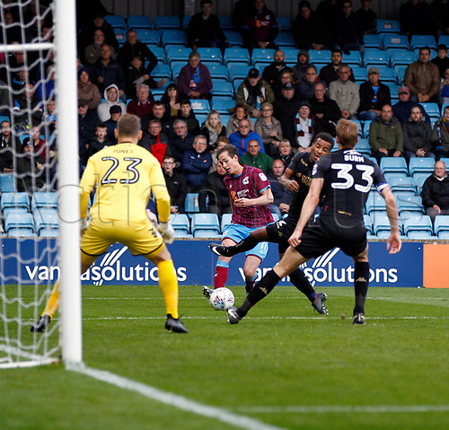7th October 2017, Glanford Park, Scunthorpe, England; EFL League One football, Scunthorpe versus Wigan; Josh Morris of Scunthorpe United crosses late in the 1-2 loss to Wigan Athletic