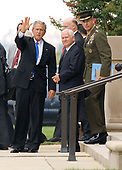 Washington, DC - August 31, 2007 -- United States President George W. Bush departs The Pentagon in Washington, D.C. after receiving briefings on the Iraq situation on Friday, August 31, 2007. From left to right: President Bush; Secretary of Defense Robert Gates; and Chairman,Joint Chiefs of Staff, General Peter Pace.<br /> Credit: Ron Sachs / CNP