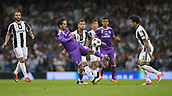 June 3rd 2017, National Stadium of Wales , Wales; UEFA Champions League Final, Juventus FC versus Real Madrid; Isco of Real Madrid and Miralem Pjanic of Juventus battle for possession during the match