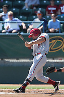 Sam Travis #6 of the Indiana Hoosiers bats against the Long Beach State Dirtbags at Blair Field on March 15, 2014 in Long Beach, California. Indiana defeated Long Beach State 2-1. (Larry Goren/Four Seam Images)