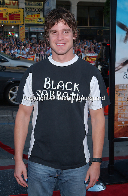 "Eddie McClintock posing at the premiere of ""Eight Legged Freaks"" at the Chinese Theatre in Los Angeles. July 16, 2002.           -            McClintockEddie29.jpg"