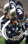 Members of the Wolf Pack Marching Band perform before an NCAA football game between Louisiana Tech and Nevada on Saturday, Nov. 19, 2011, in Reno, Nev. (AP Photo/Cathleen Allison)