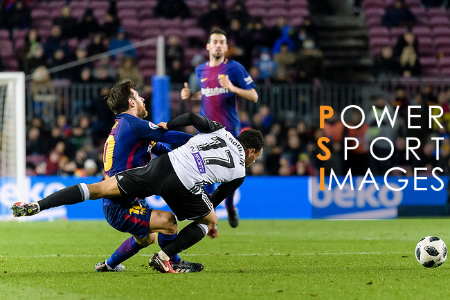 Lionel Messi of FC Barcelona (L) fights for the ball with Francis Qoquelin of Valencia CF (R) during the Copa Del Rey 2017-18 match between FC Barcelona and Valencia CF at Camp Nou Stadium on 01 February 2018 in Barcelona, Spain. Photo by Vicens Gimenez / Power Sport Images